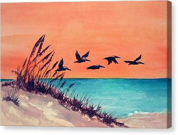 Pelicans Flying Low Canvas Print