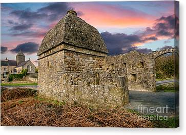 Penmon Priory Sunset Canvas Print by Adrian Evans