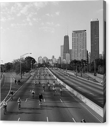 People Cycling On A Road, Bike The Canvas Print by Panoramic Images