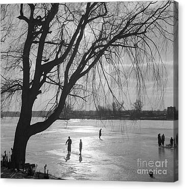 People Ice Skating On A Frozen Over Lake Canvas Print