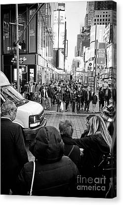 Crosswalk Canvas Print - people waiting at crosswalk with full busy sidewalk in the evening evening in Times Square New York  by Joe Fox