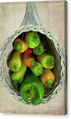 Canvas Print featuring the photograph Peppers In A Horn Of Plenty Basket by Dan Carmichael