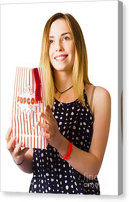 Person At Movie Cinema With Popcorn Bag Canvas Print by Jorgo Photography - Wall Art Gallery