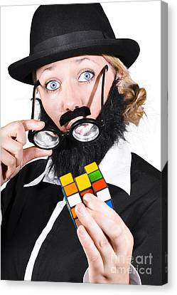 Person Holding Eyeglasses Showing Cube Puzzle Canvas Print by Jorgo Photography - Wall Art Gallery