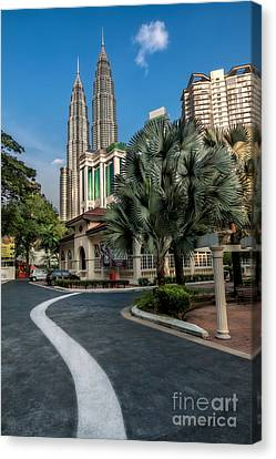 Petronas Towers Canvas Print by Adrian Evans