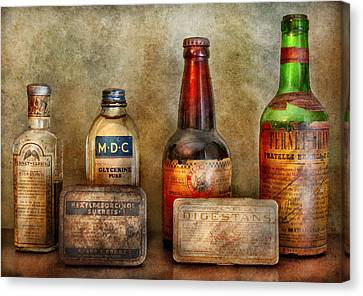 Pharmacist - On A Pharmacists Counter Canvas Print by Mike Savad