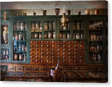 Pharmacy - Right Behind The Counter Canvas Print by Mike Savad