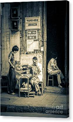Phonecall On Chinese Street Canvas Print by Heiko Koehrer-Wagner