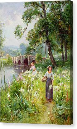Picking Flowers By The River Canvas Print by Ernest Walbourn