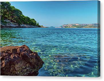 Picturesque Croatia Offers Tourists Pristine Beaches Of The Adriatic, Surrounded By Pine Trees And R Canvas Print