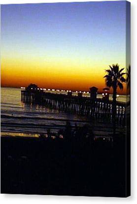 Canvas Print featuring the photograph Pier At Sunset by Amanda Eberly-Kudamik