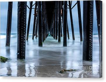 Pier Into The Ocean Canvas Print by Leo Bounds