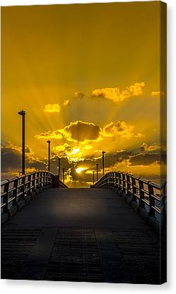 Pier Into The Rays Canvas Print by Marvin Spates