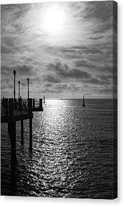 Canvas Print featuring the photograph Pier Into The Sun by Michael Hope