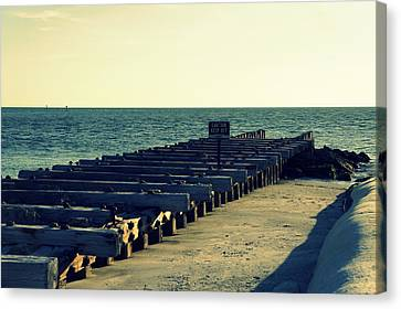 Pier Of The Past Canvas Print by Laurie Perry