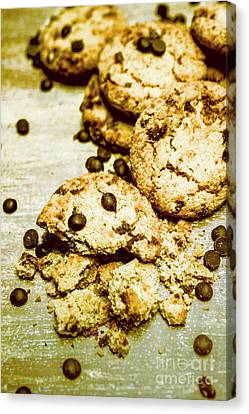 Pile Of Crumbled Chocolate Chip Cookies On Table Canvas Print by Jorgo Photography - Wall Art Gallery