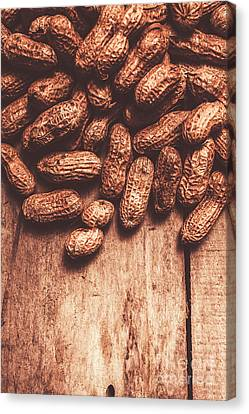 Pile Of Peanuts Covering Top Half Of Board Canvas Print by Jorgo Photography - Wall Art Gallery