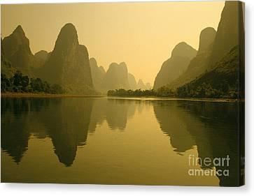 Piled Silk Mountain Reflections Canvas Print by Joe Carini - Printscapes