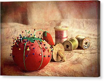 Fabric Canvas Print - Pin Cushion And Wooden Thread Spools by Tom Mc Nemar