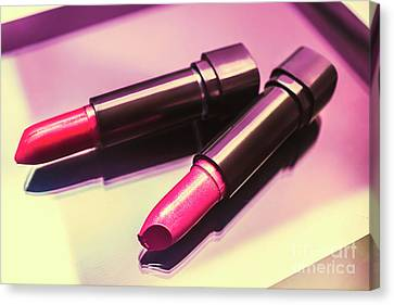 Pink And Rouge Lipsticks On Table Canvas Print by Jorgo Photography - Wall Art Gallery