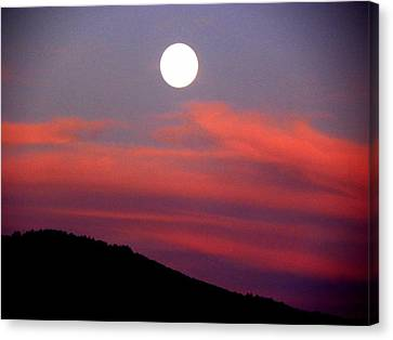 Pink Clouds With Moon Canvas Print by Joseph Frank Baraba