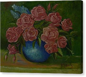 Pink Roses In A Blue Vase Canvas Print
