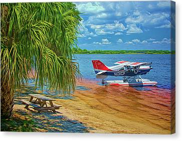 Canvas Print featuring the photograph Plane On The Lake by Lewis Mann