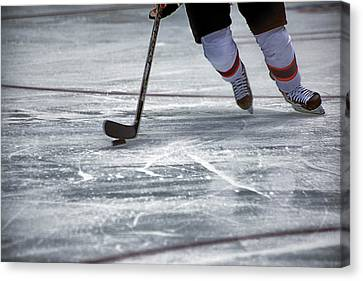 Player And Puck Canvas Print by Karol Livote