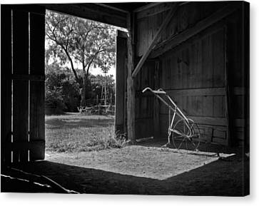 Plow Is In The Barn Canvas Print by David and Carol Kelly