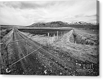 plowed field with drainage ditches dug beside fields in Iceland Canvas Print by Joe Fox