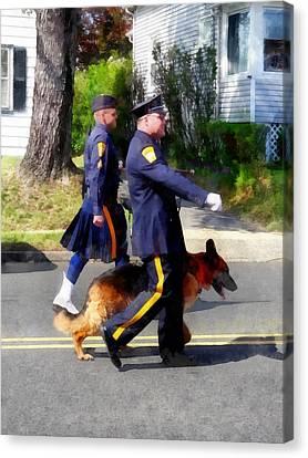 Policeman And Dog In Parade Canvas Print by Susan Savad