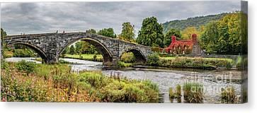 Pont Fawr Bridge Llanrwst Canvas Print by Adrian Evans