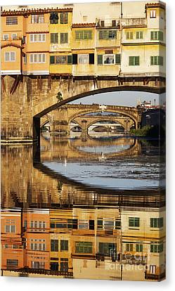Ponte Vecchio Crossing The River A Canvas Print by Jeremy Woodhouse