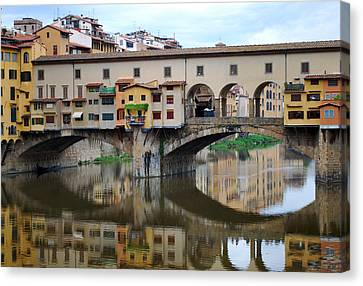 Ponte Vecchio Reflects. Canvas Print by Terence Davis