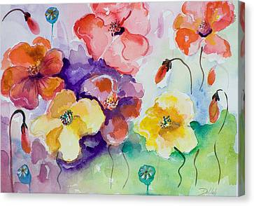 Poppies Of Color Canvas Print by Delilah  Smith