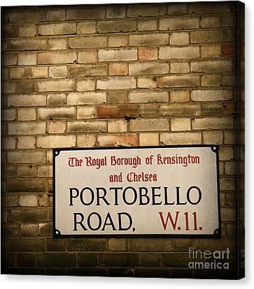 Portobello Road Sign On A Grunge Brick Wall In London England Canvas Print by ELITE IMAGE photography By Chad McDermott