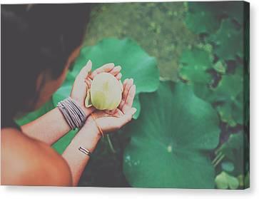 Srdjan Kirtic Canvas Print - Portrait Of A Girl Holding Gently A Lotus Flower In Her Hands by Srdjan Kirtic