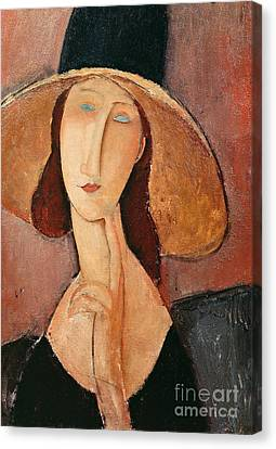 Late Canvas Print - Portrait Of Jeanne Hebuterne In A Large Hat by Amedeo Modigliani