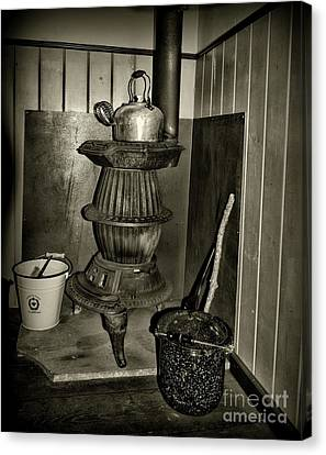 Pot Belly Stove In Black And White Canvas Print by Paul Ward