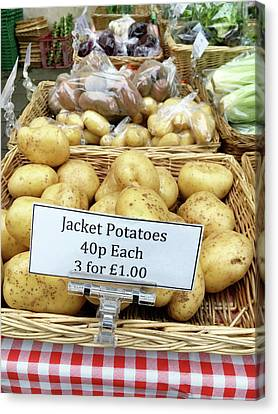Potatoes At The Market  Canvas Print by Tom Gowanlock