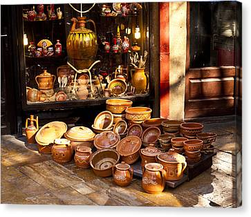Pottery In The Bazaar Canvas Print by Rae Tucker