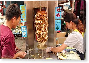 Canvas Print featuring the photograph Preparing Shawarma Meat In Bread Buns by Yali Shi