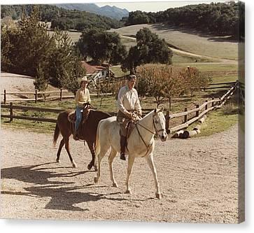 President And Nancy Reagan Horseback Canvas Print by Everett
