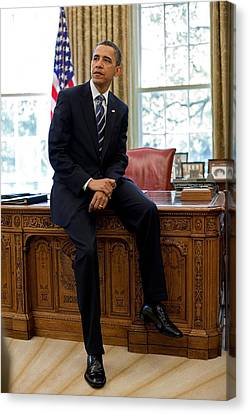 President Barack Obama Sits On The Edge Canvas Print by Everett