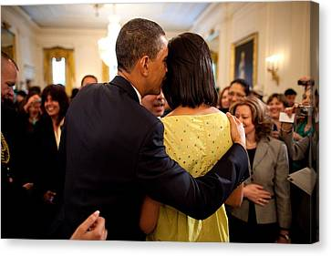 President Obama Whispers Into Michelles Canvas Print by Everett
