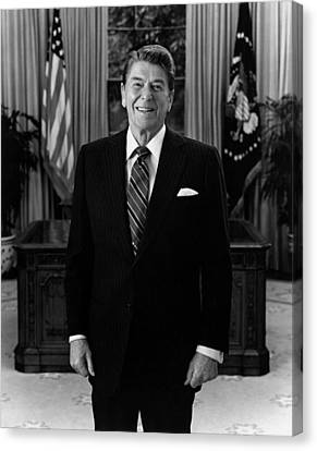 President Ronald Reagan In The Oval Office Canvas Print by War Is Hell Store