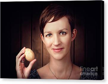 Pretty Young Brunette Woman Holding Hatching Egg Canvas Print by Jorgo Photography - Wall Art Gallery