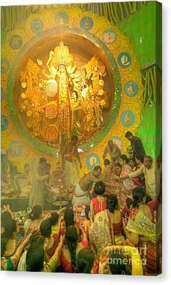 Priest Distributing Flowers For Praying To Goddess Durga Durga Puja Festival Kolkata India Canvas Print by Rudra Narayan  Mitra