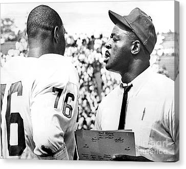 Rosy Hall Canvas Print - Pro Football Hall Of Famer, Rosy Brown Gives Pointers To Rookie Tackle, Don Davis. 1966 by William Jacobellis
