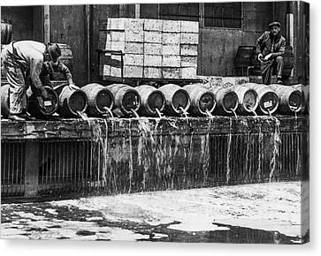 Prohibition - Down The Drain Canvas Print by Bill Cannon